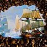 На фото -картинка с парусниками в обрамлении кофейных зёрен
